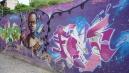 Graffitin ábrázolt favela-kid.